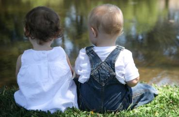 Children Sitting by a Pond