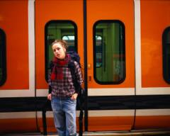 Teen getting on a train.jpg